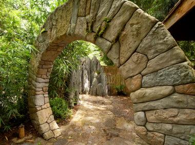 Stone sculpture garden gate