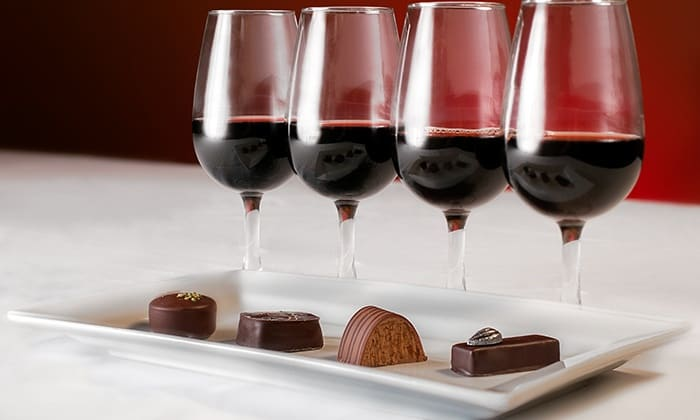 Glasses of red wine and chocolates