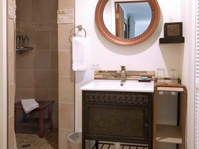 Cape Falttery Cottage bathroom with vanity and walk-in shower