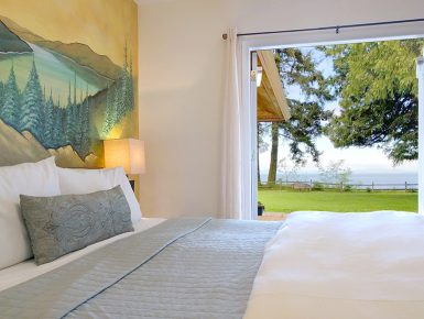 Lake Crescent Suite ith door leading outdoors