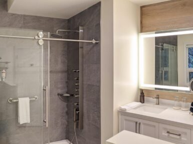 Image of bathroom with large glass shower and sink