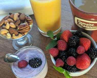 Nuts, fruit, orange juice and coffee