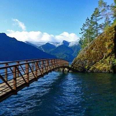 bridge over water between mountains