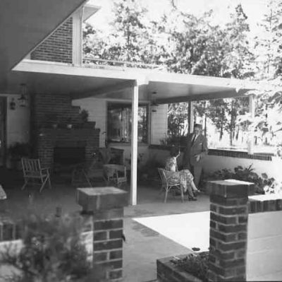 Historical view of man and lady relaxing on patio