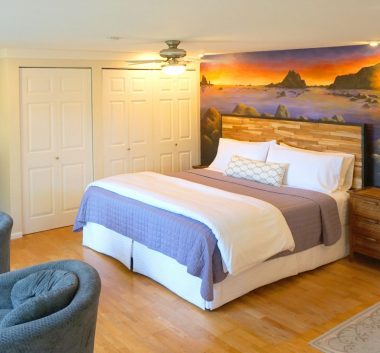Rialto Beach Cottage with murial behind bed