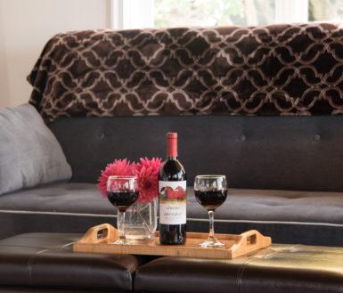 Wine bottle in front of a sofa