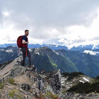 Hiker on top of a rocky peak